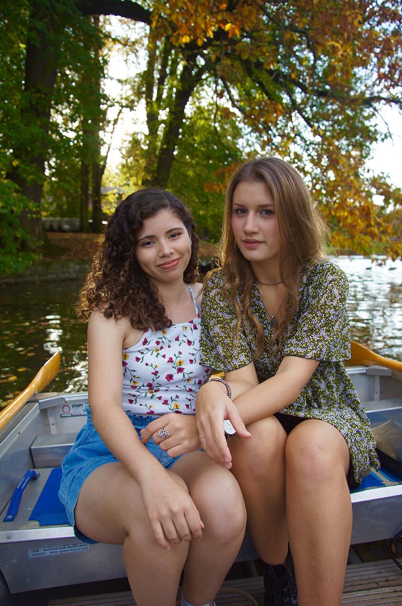Carolina and Alessia sitting on a boat