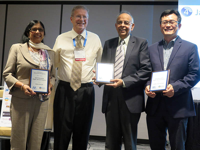 Professors Uma Kumar and VInod Kumar and Dong-Young Kim (PhD/10) from the University of North Florida are presented with award plaques for the Jack Meredith Award.
