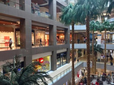 The palm-tree lined interior of the Costanera Centre, Santiago's massive shopping mall in Las Condes.