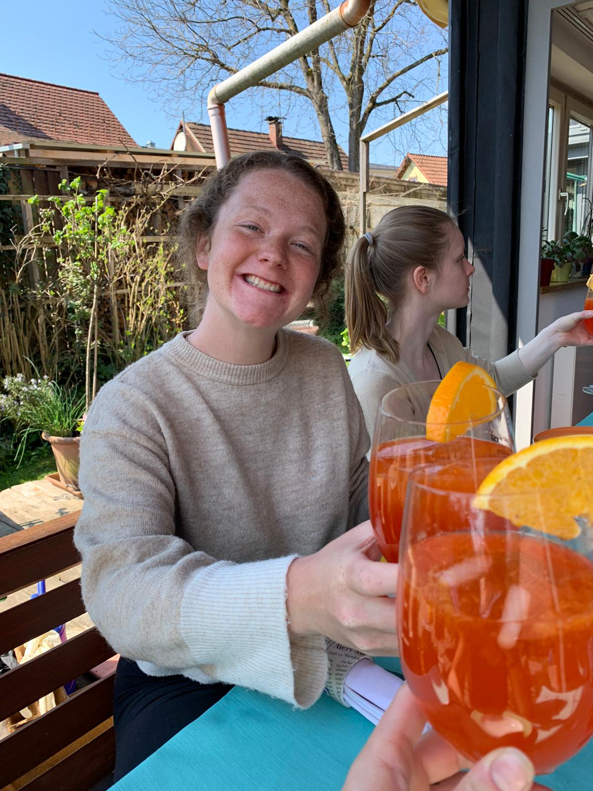 Ceiledh holding a glass of Aperolspritz