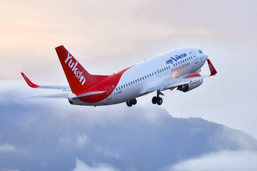 An Air North Yukon airplane taking off