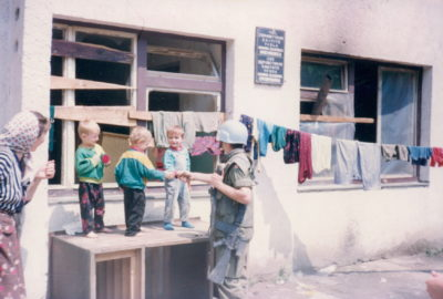 Lieutenant Andrew Webb interacting with local children in Bosnia, 1993.
