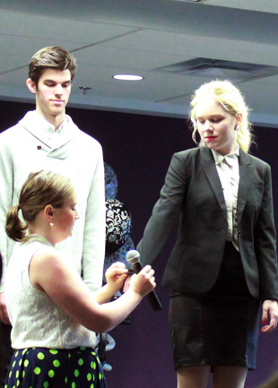 Image consultant Wendy Woods teaching students about the proper fit of a blazer.