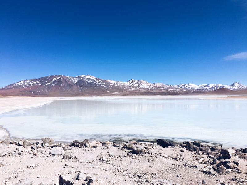 The ocean and mountains of the salt lands with a clear blue sky