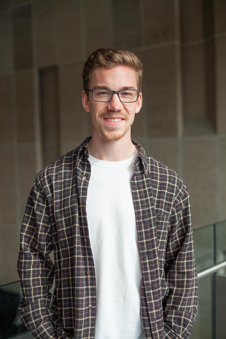 Blake in a plaid shirt in the Richcraft Atrium