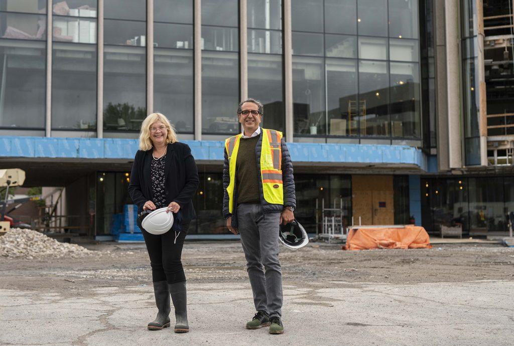 Dana Brown and Siamak Hariri in front of the Nicol Building under construction
