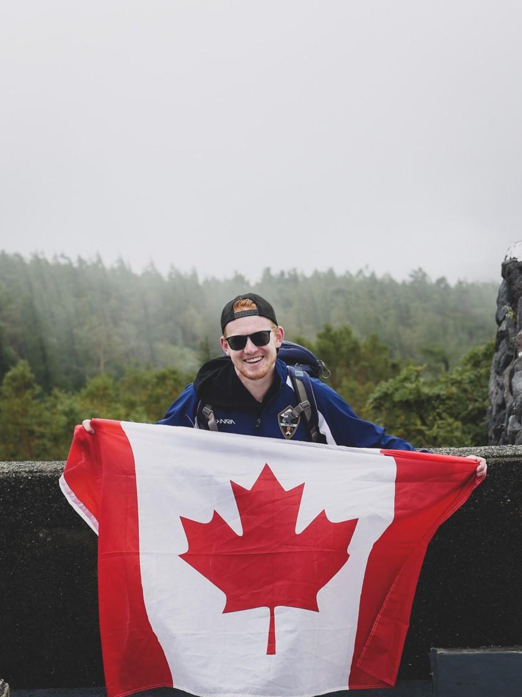 Braydon holding up a Canada flag