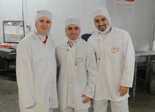 Rodrigo with his 2 bosses from Averama in white coveralls touring the plant.