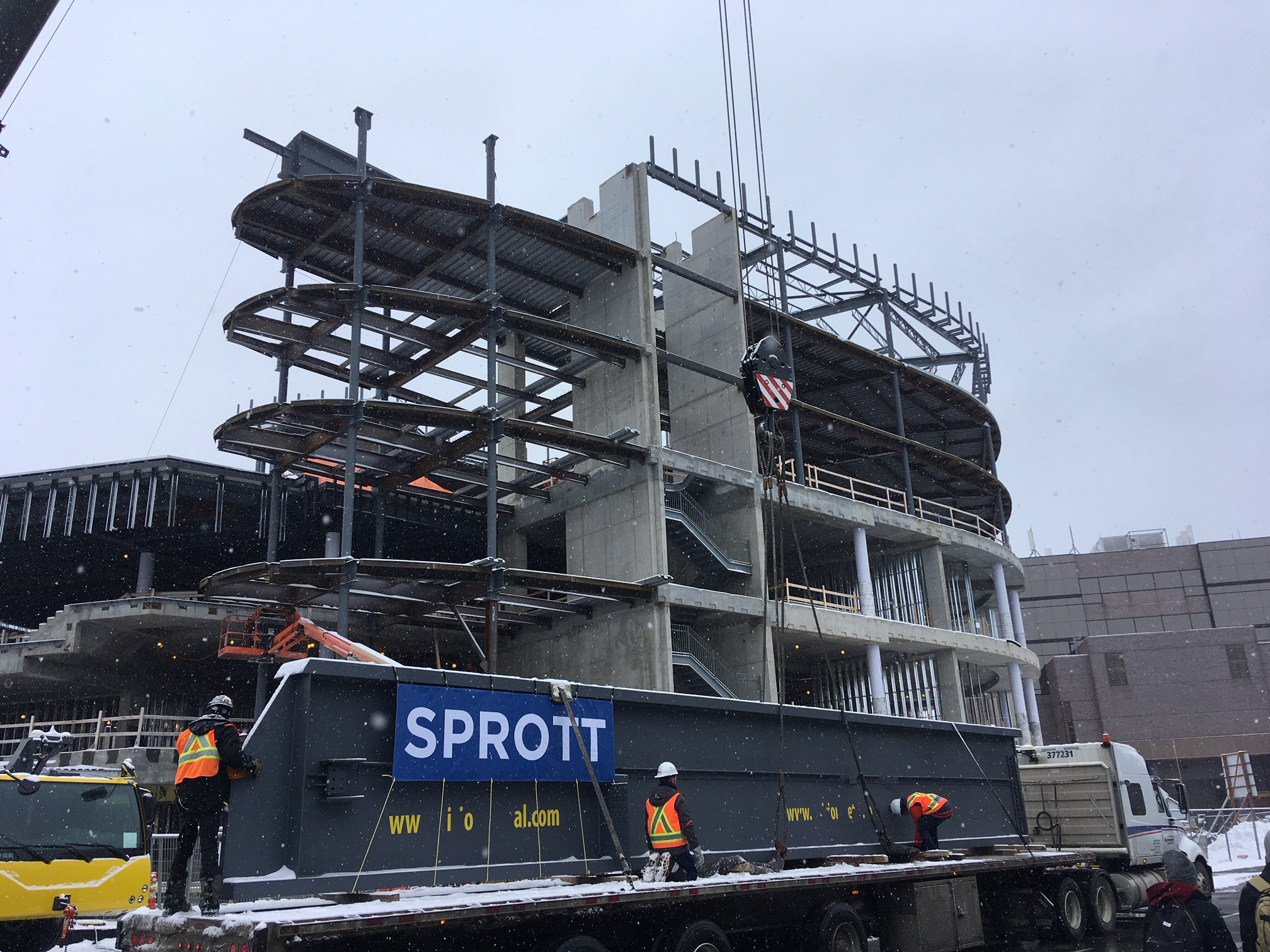A SPROTT banner on top of the mega beam on the truck