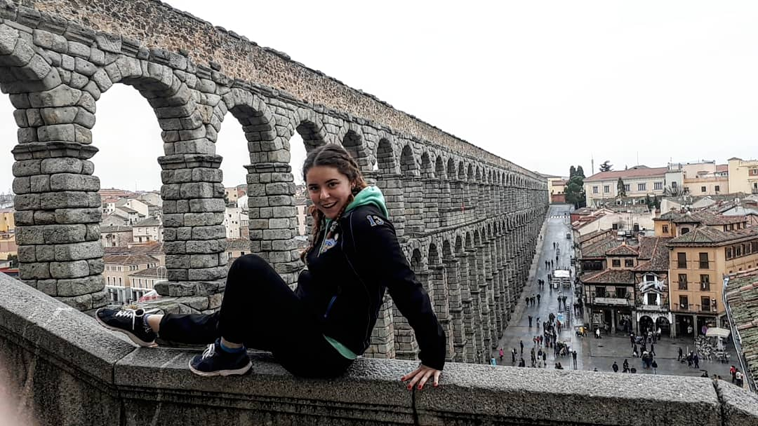 Me sitting on the wall by the aqua ducts in Segovia