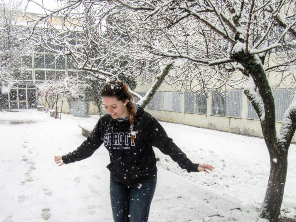 Ali dancing in the snow on campus