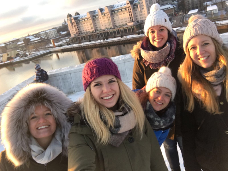 Spencer and her friends in front of the Oslo Norway Opera House