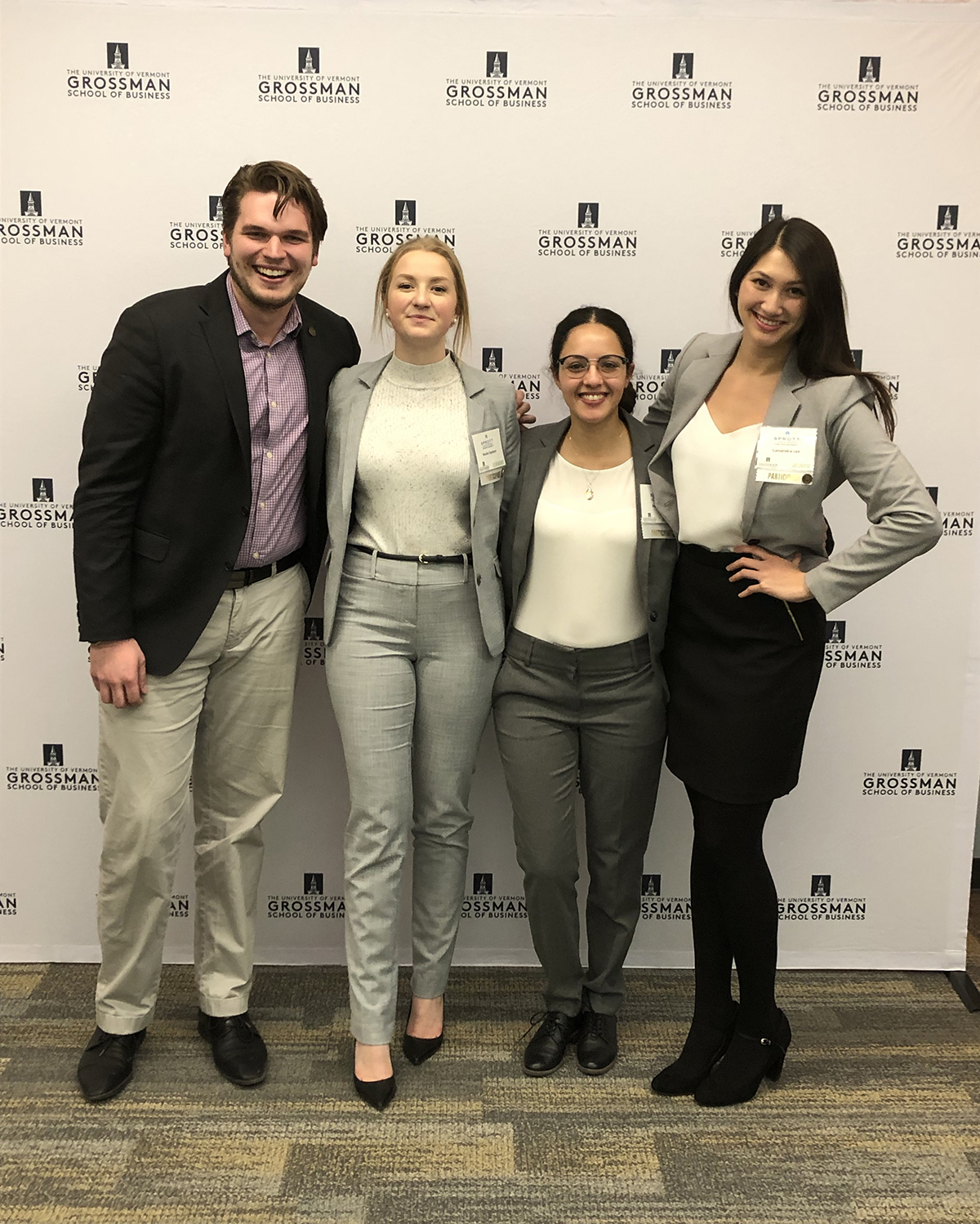 Coach Liam Gravely pictured with Sprott team members Nicole Opsteen, Hala Saoudi, and Cassandra Lee, at the University of Vermont's Global Family Enterprise Case Competition.