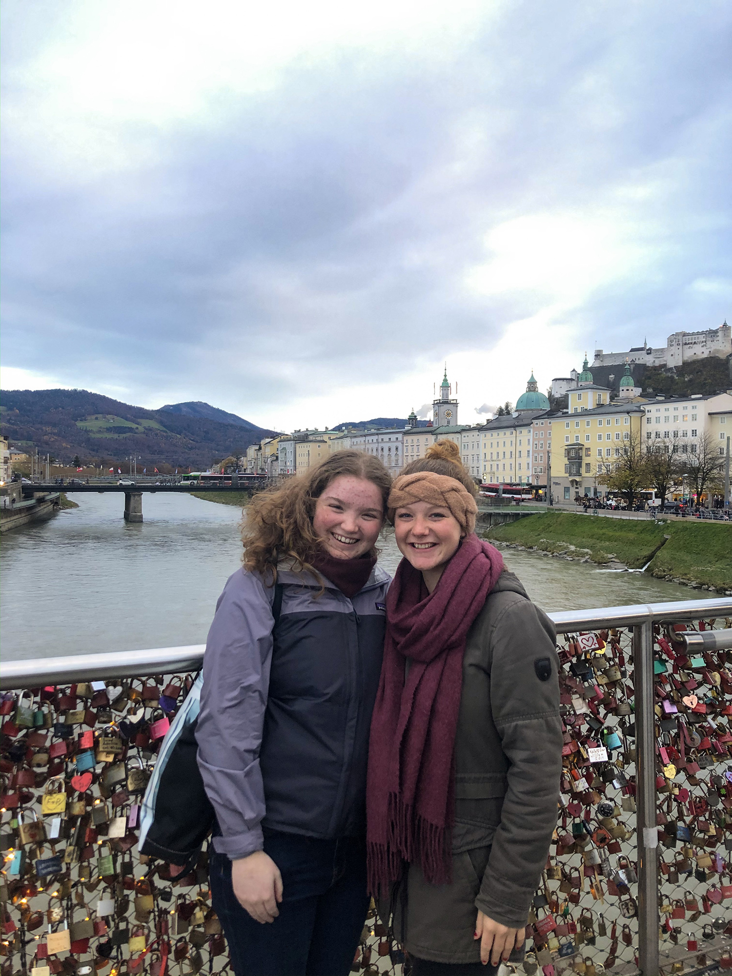Ceiledh and her friend posing on a bridge full of combination locks.