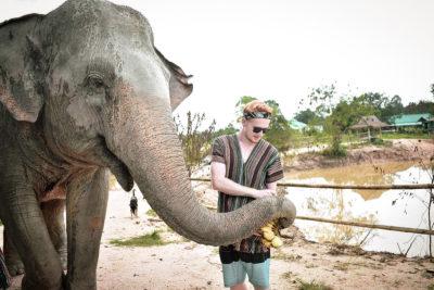 A student, Braydon Armula, feeding an elephant in Thailand.