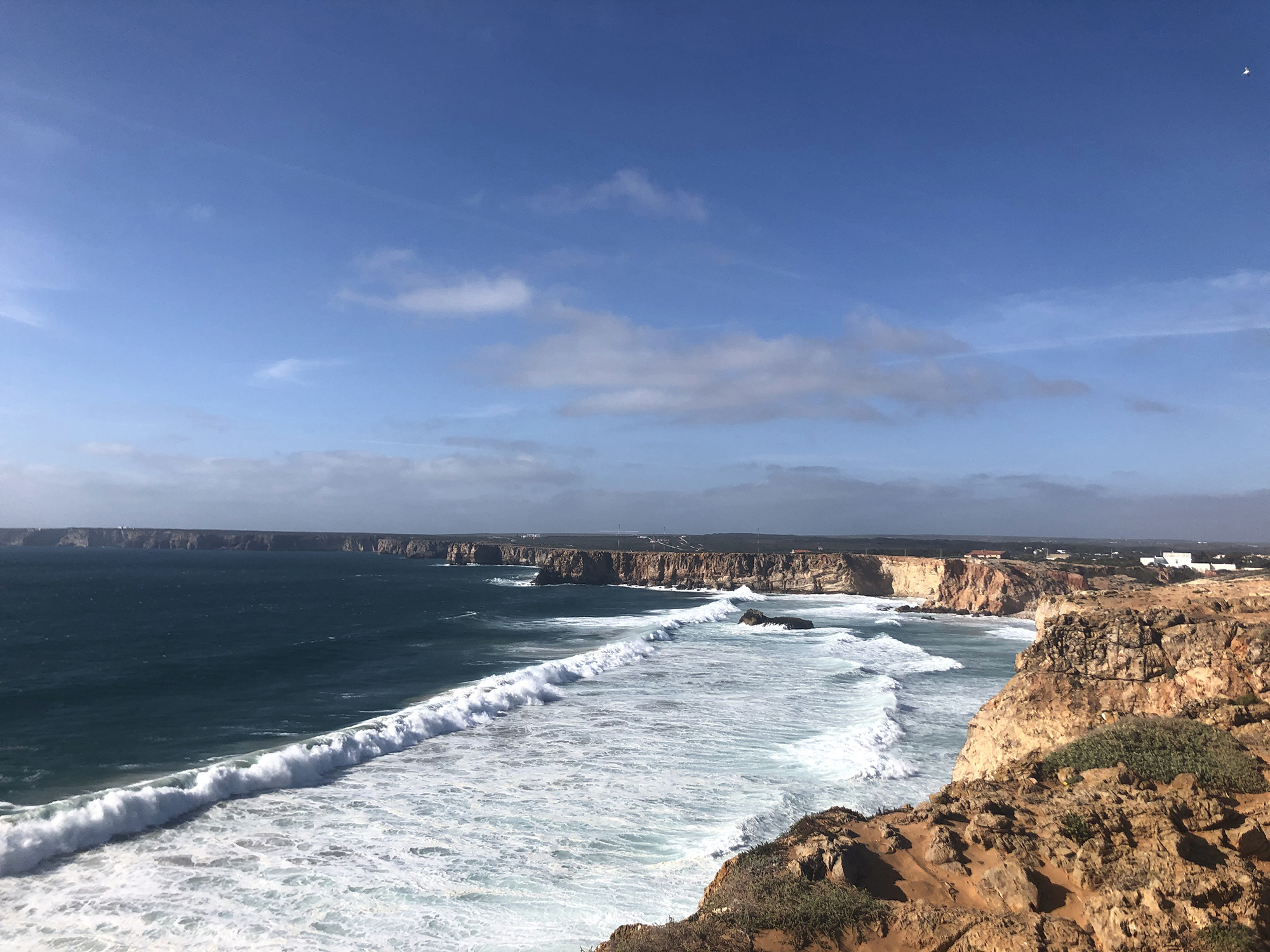 A view of the shoreline and the blue sky in Sagres, Portugal