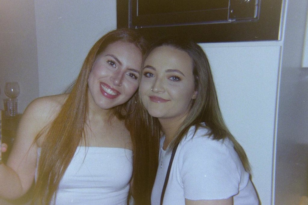 Lauren and Georgia wearing white shirts
