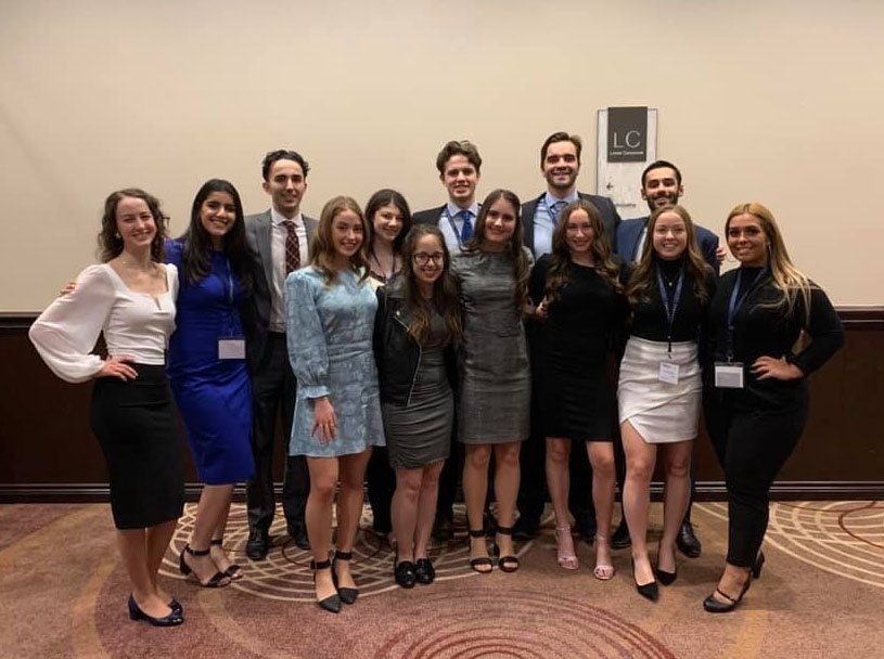 A formal photo of the DECA team