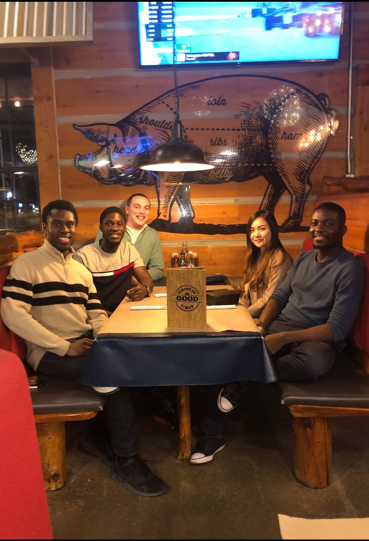 Chris and four friends at a table at Montana's restaurant
