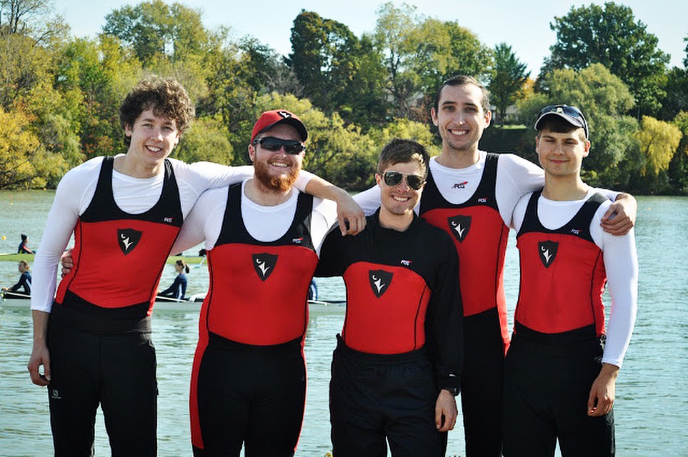 5 rowing members in uniform