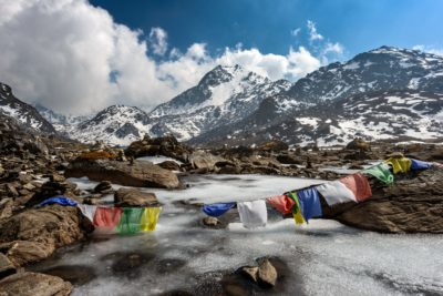 Coloured flags on the summit of a mountain in Nepal