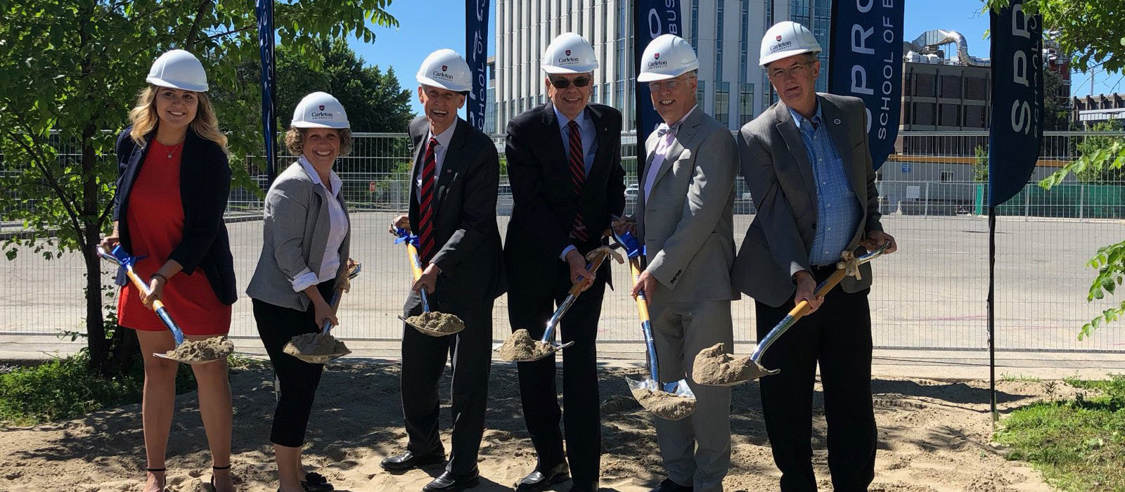 SBSS President Hanna Di Virgilio, Interim Dean Linda Schweitzer, Interim Provost Jerry Tomberlin, Board of Governors Chair Chris Carruthers, Bruce Nicol and Associate VP Darryl Boyce break ground for the Nicol Building at Carleton University.