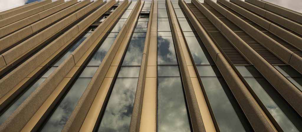 photo of Nicoll Building exterior and close-up on the windows and system of concrete fins.