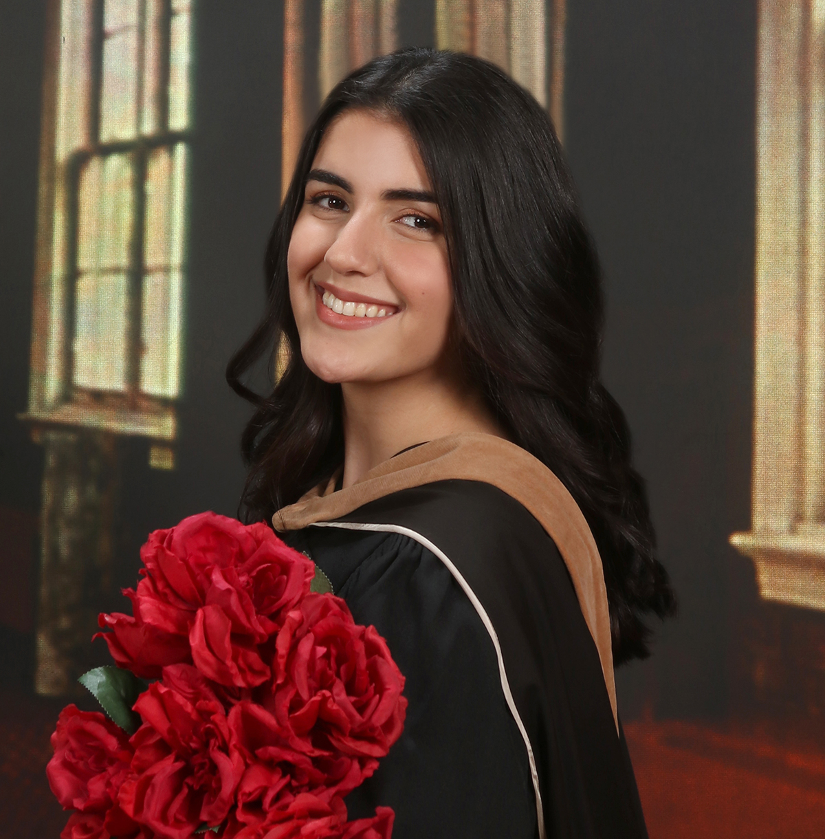 Lina in her graduation gown and flowers