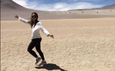 Alex running through the sand