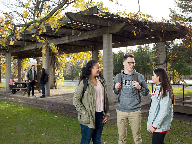 Sprott students outside on campus at Carleton University.