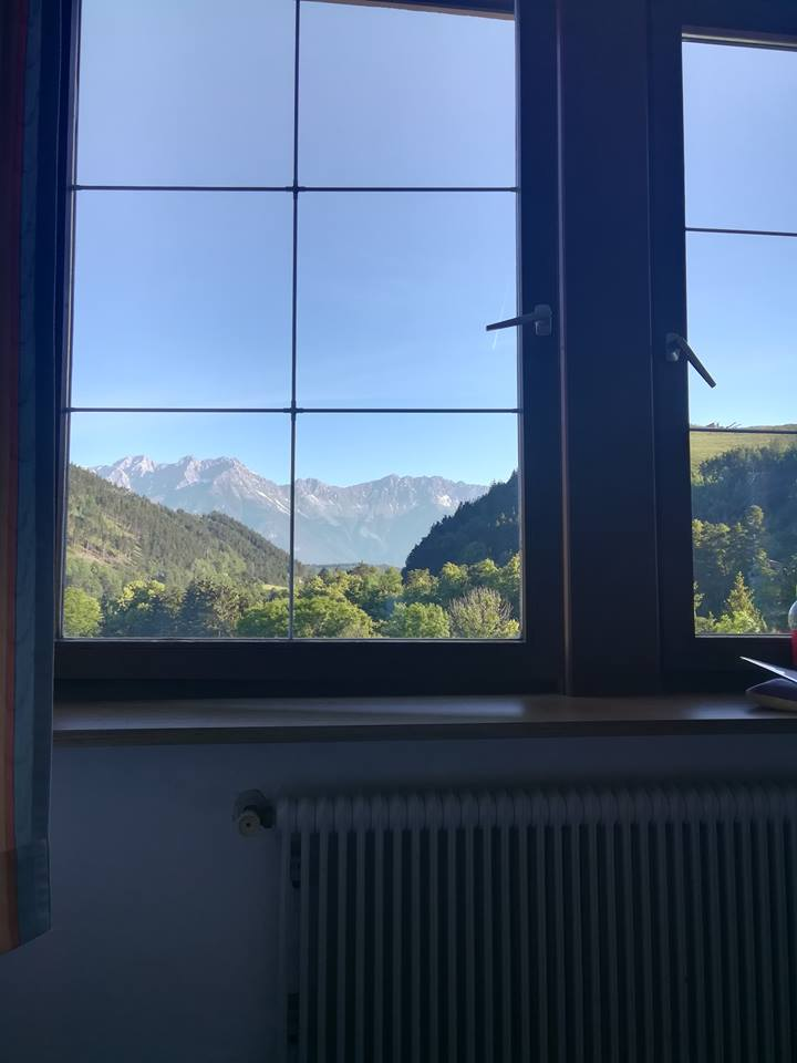 a view of the mountains from the hotel window in Innsbruck
