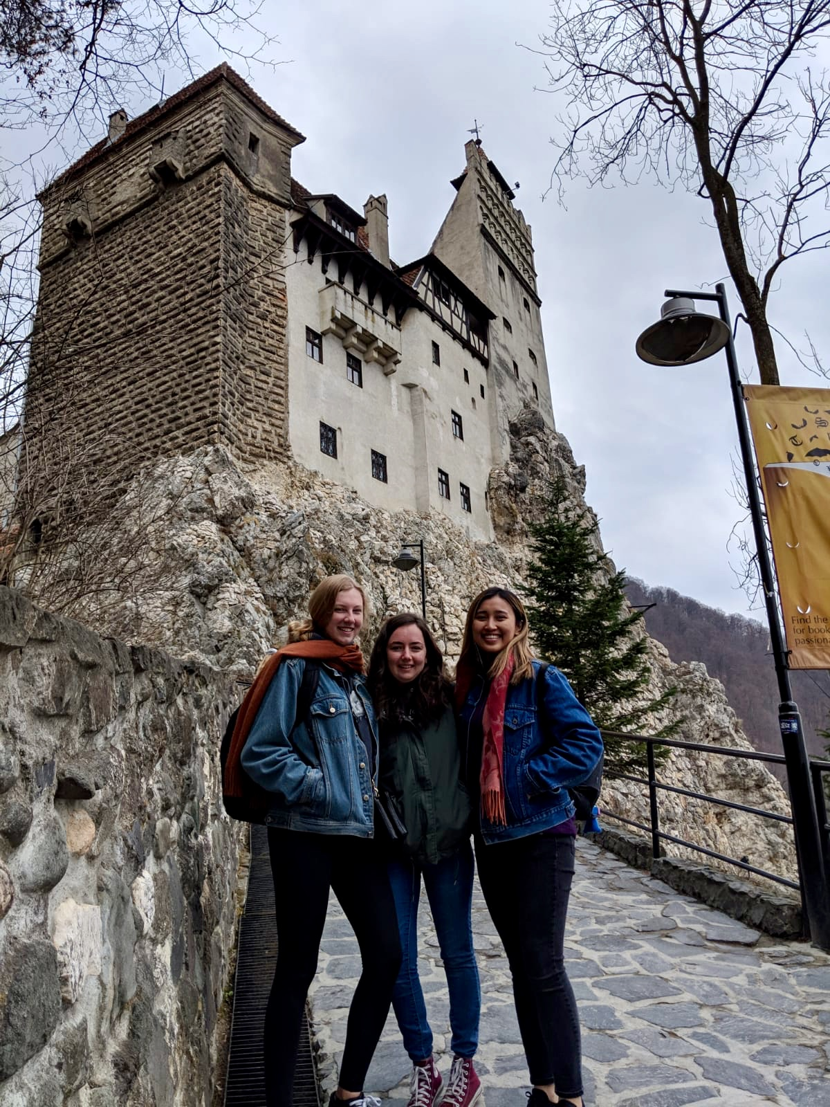 Jasmine and 2 friends in front of Bran Castle