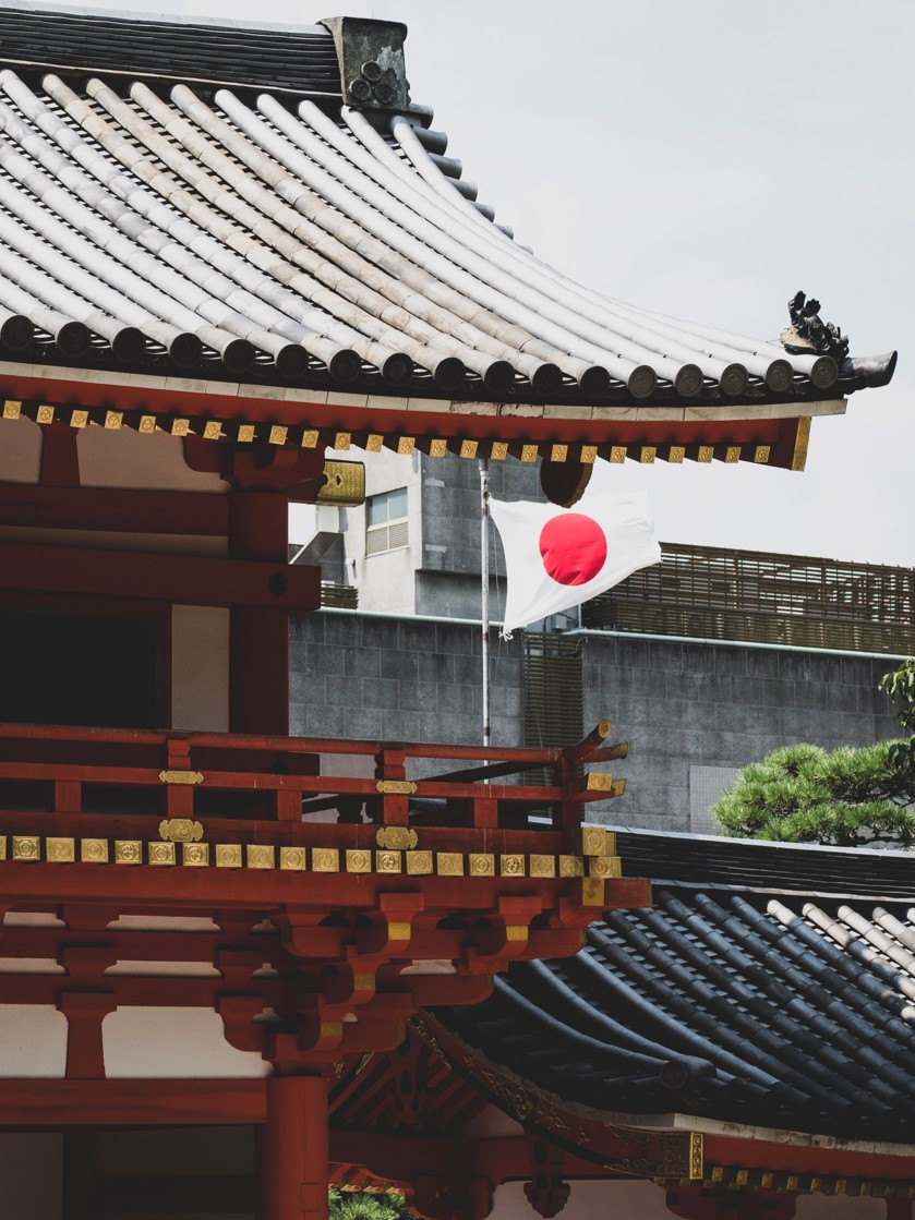 A Japanese flag flying from a house