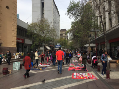 Vendors stretch along Paseo Estado, a pedestrian street in downtown Santiago.