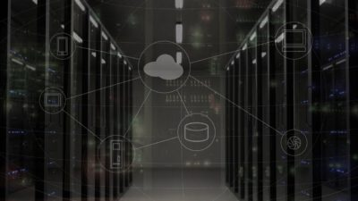 a room of servers with a cloud graphic overlay