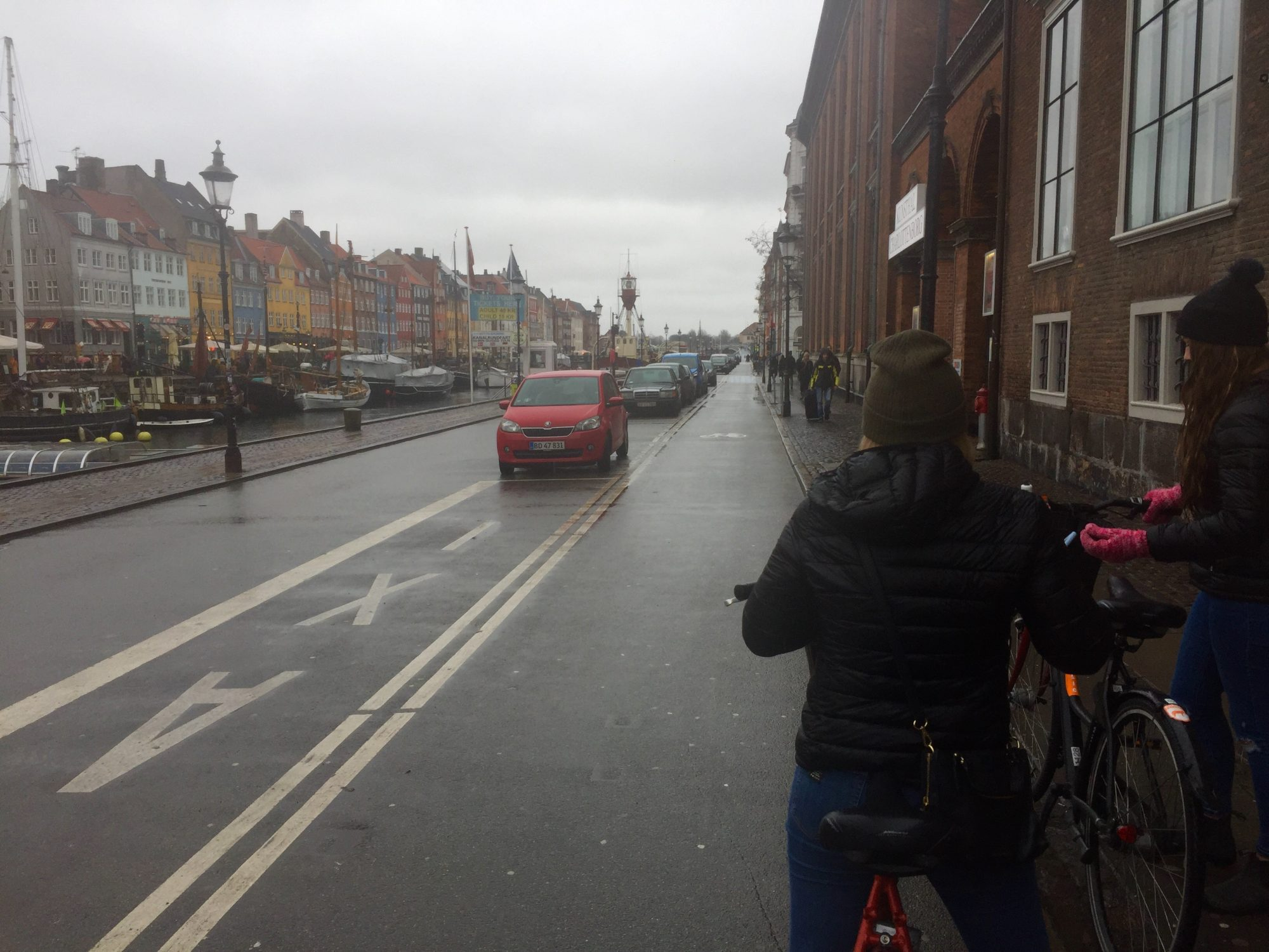Nyhavn, Copenhagen. We chose the coldest and rainiest day to bike around Copenhagen, but nevertheless I think biking is the best way to see Copenhagen!