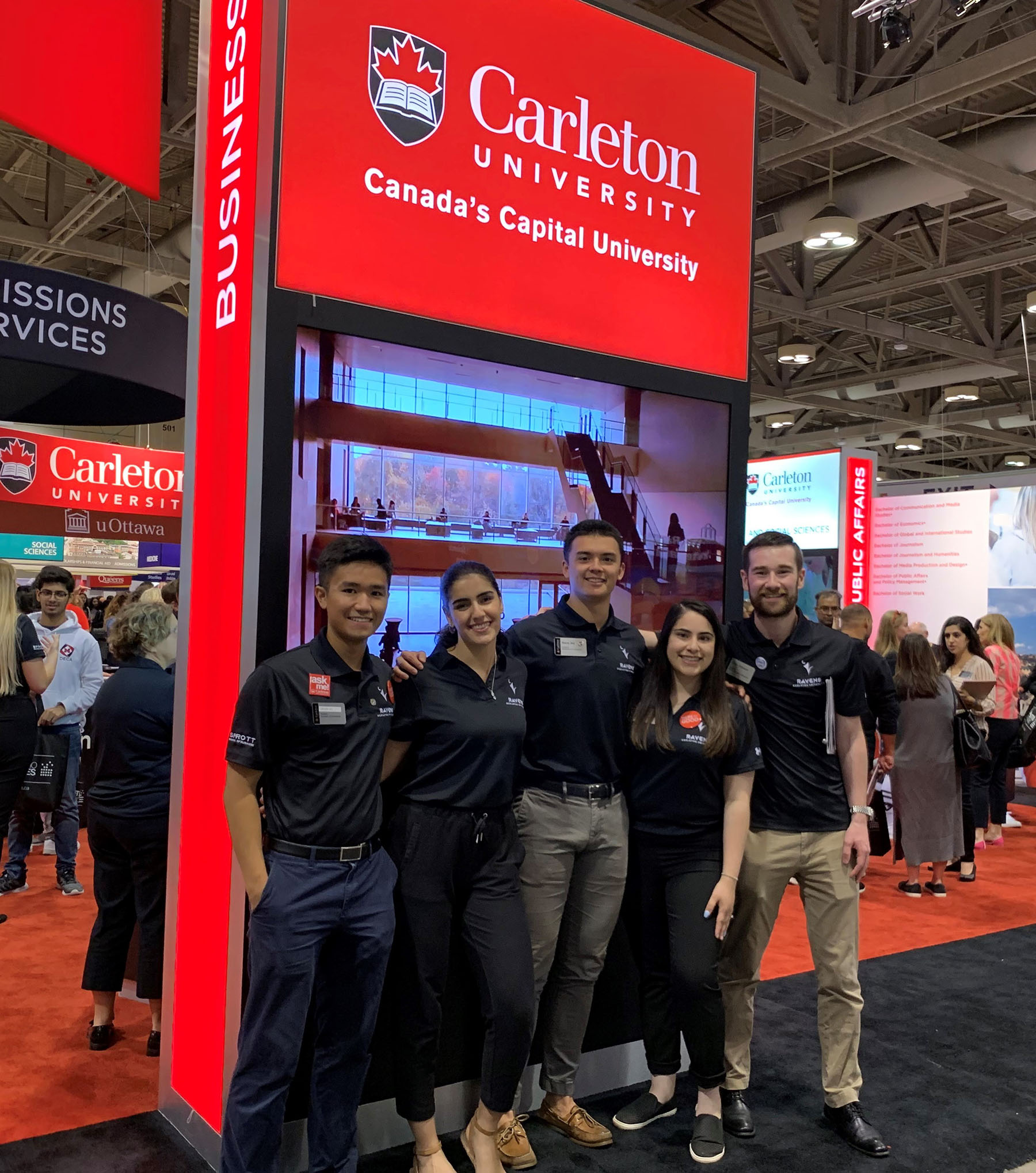 Lina with 4 other Sprott students wearing matching polo shirts at the Ontario Universities Fair