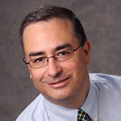 Headshot of José Rojas-Méndez