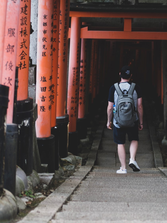 Braydon walking past orange posts with writing