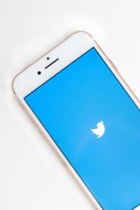 iphone showing the Twitter logo on the screen.