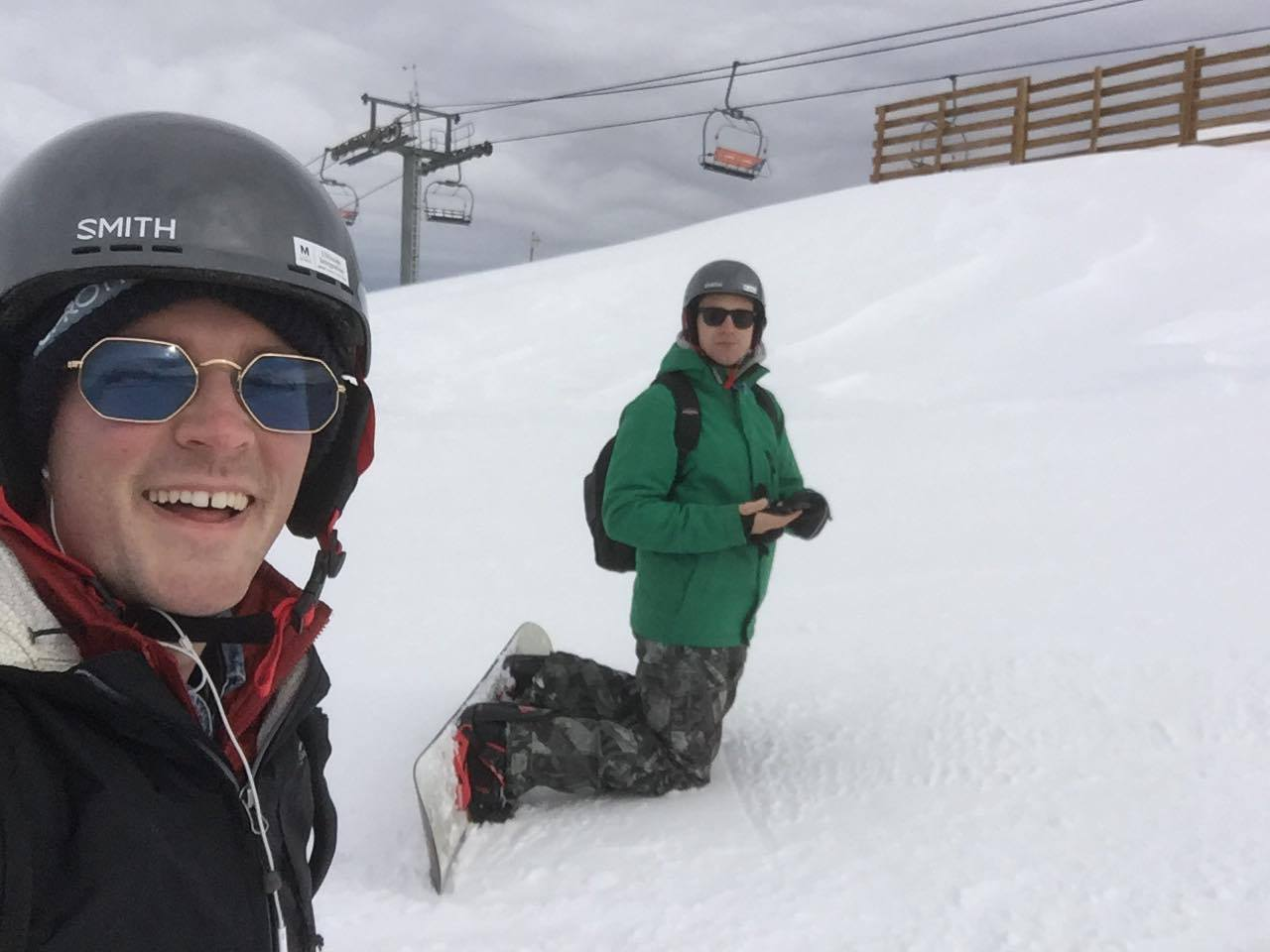 Zach and Isaac snowboarding
